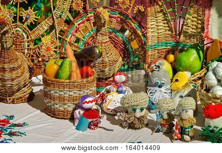 Basketry and Souvenirs in the form of amusing dolls are sold at the fair..
