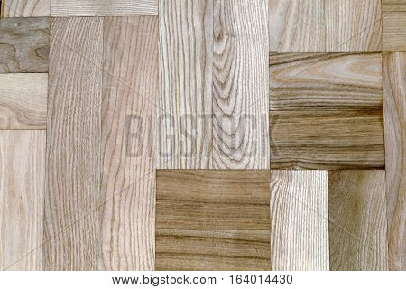 The background image of the boards from natural wood of different breeds with pronounced structure of the wood.