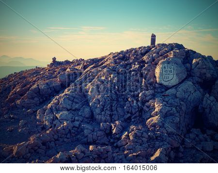 Peak Of Hoher Goell, Tourist Trail Marks On Boulder At Mountain Top In Alps