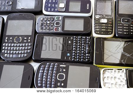 Old mobile phones isolated on white background