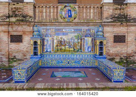 Seville, Spain - January 2, 2017: Glazed tiles bench of spanish province of Toledo at Plaza de Espana Seville Spain