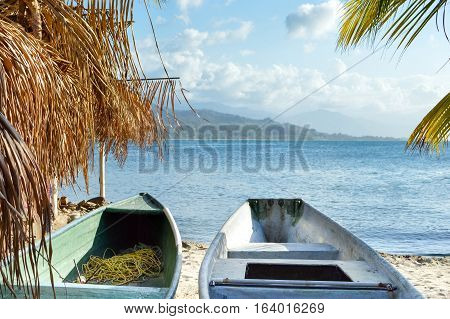 Colorful boats and the beautiful tropical coast of the Caribbean sea by the little town of Omoa in Honduras. Central America