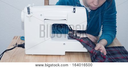 Seamstress woman searching for quality. Looking for failures