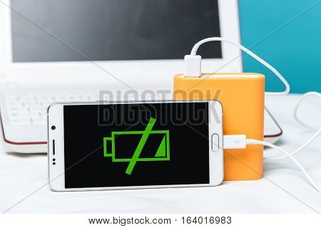 A Smartphone With The Power Bank In The Foreground Of The Camera. Nescessity To Take A Charger With