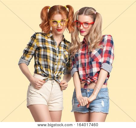 Fashion Hipster woman Having Fun Crazy Cheeky. Hipster Sisters Best Friends Smile. Twins in Trendy Plaid Shirt. Funny Model Girl Fashion Sunglasses. Nerd in Glamour fashion Outfit, Hairstyle