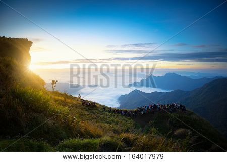 Tourists looking at sunrise at Phu Chi Fa in Chiang rai Thailand.