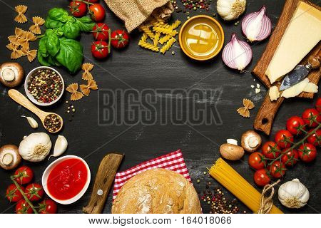 Italian food or ingredients background with fresh vegetables pasta cheese parmesan and spices. Top view view from above. Copy space.