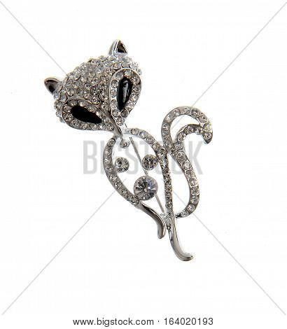 silver brooch shaped cat isolated on white background