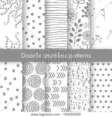 Set of vector spring patterns with flowers, doodle pattern, branches, leaves, dots, hearts. Gray and white colors. Seamless pattern is in the swatches palette.