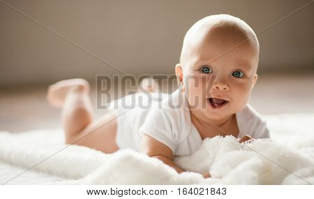 Portrait Of Small Smiling  Baby.