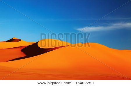 Sand dune in Sahara Desert at sunset