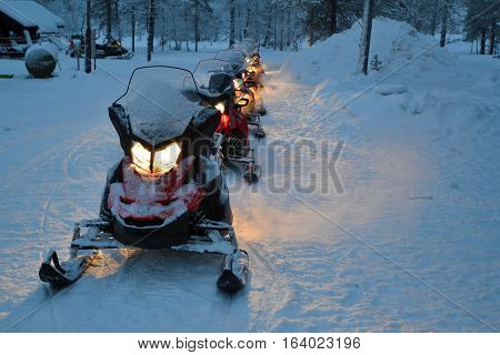 line up of snowmobiles ready for an excursion