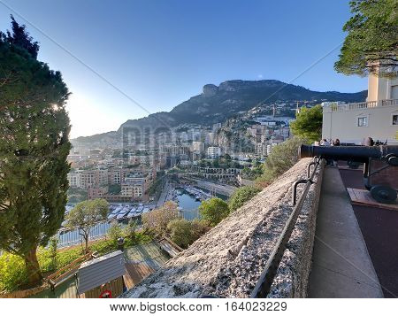 View of city of monaco district fontvieille with the harbor harbour mountain hill and sunset hdr