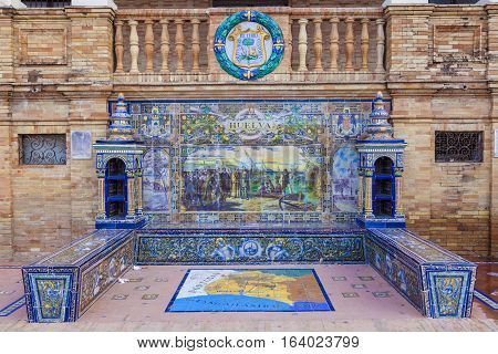 Seville, Spain - January 2, 2017: Glazed tiles bench of spanish province of Huelva at Plaza de Espana Seville Spain