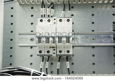 Close-up of electrical fusebox. Depth of field on the central switch