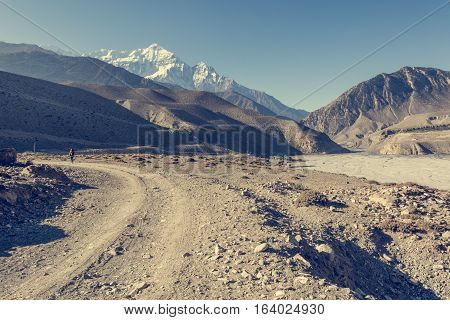 Dirt road following river bed. Kali Gandaki valley - Annapurna circuit trek in Nepal.