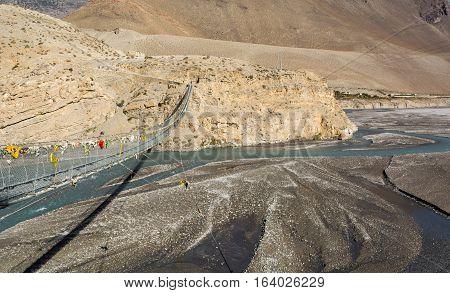 Metal suspension bridge. Kali Gandaki valley in Nepal.