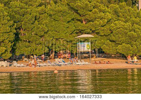 TUCEPI, CROATIA - September 20, 2016 Last tourists enjoying on the town beach.
