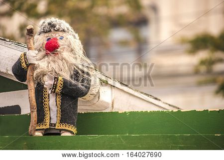 The doll representing an old man with beard and staff