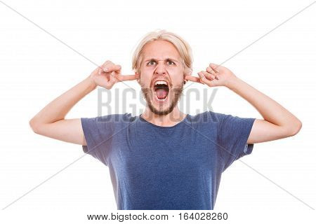 Stressful unpleasant situation conflict. Angry mad young man plug closing ears with fingers protecting from loud noise. Guy not wanting to listen isolated on white