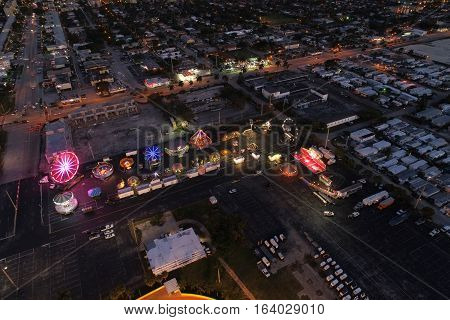 Carnival illuminated at night aerial drone image