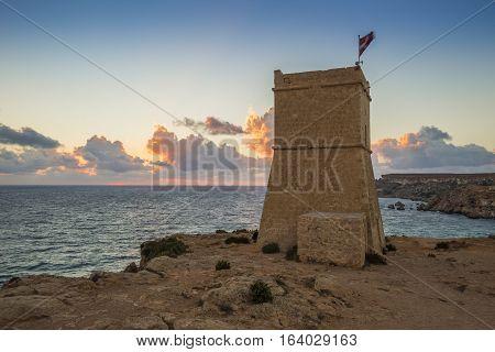 Malta - Ghajn Tuffieha watchtower at Golden Bay before sunset