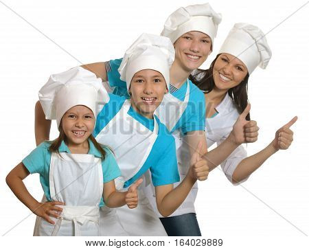 big happy family wearing aprons with thumb ups posing against white