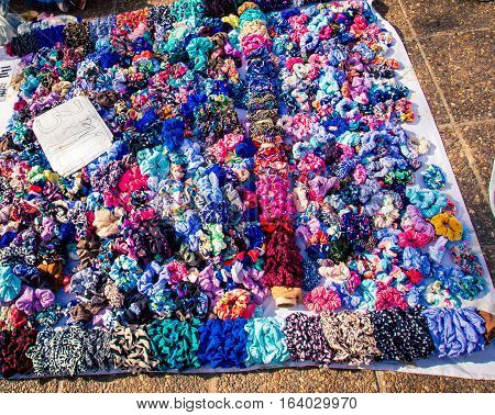 Colorful hair scrunchies for sale at the Feria de Mataderos