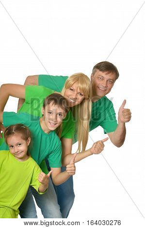 big happy family with thumb ups posing against white
