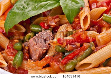 Close-up of penne pasta with meatvegetable and tomato souce