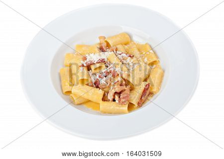 Iitalian rigatoni plate with prosciutto parmesan cheese isolated on white background.