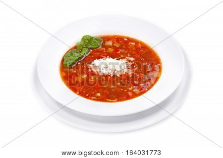 Minestrone - light soup of seasonal vegetables. Italian cuisine. Isolated on white background.