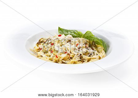 Italian pasta on the plate isolated on a white bakground.