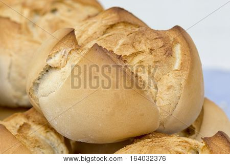 Closeup image of a big round bread loaf.
