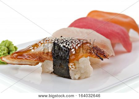 Еasty fresh japanese sushi on white background.