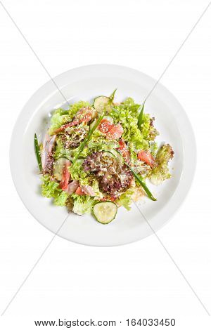 Salat with meat and lettuce on the plate