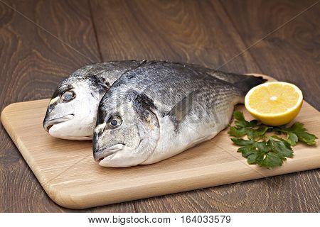 Dorada fish with lemon prepared for cooking.