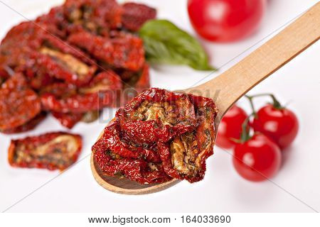 Sun dried tomatoes with basil and fresh tomatoes
