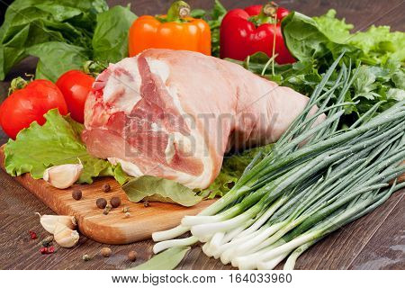 Shank of Pork with vegetables and harbs