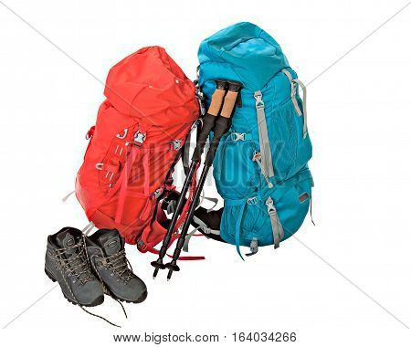 Hiking equipment rucksacks poles and boots. Isolated on white background.