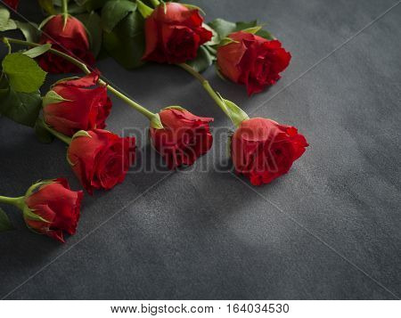 condolence card with Red Roses on grey marble background