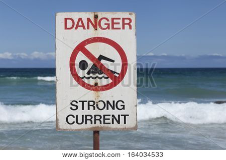 Dangerous currents sign at Bondi Beach in Sydney Australia. On a sunny day