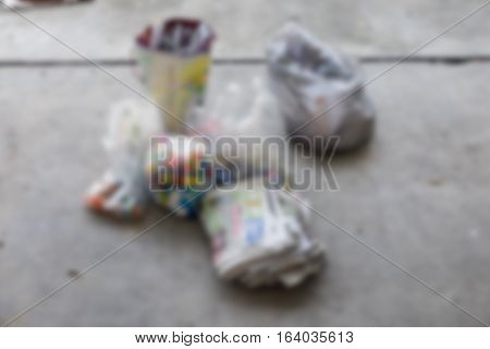 Blur background dumpsters being full with garbage