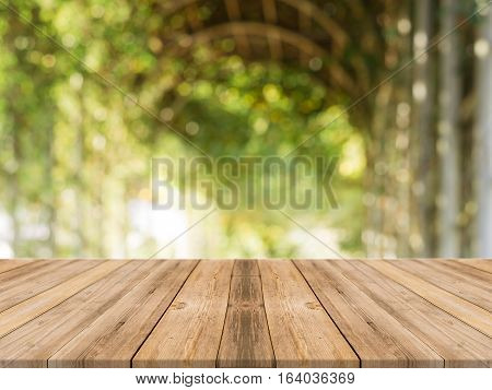 Wooden board empty table in front of blurred background. Perspective brown wood table over blur trees in forest background - can be used mock up for display or montage your products. spring season.