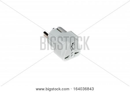 Close up universal American UK to European travel adapter converter plug. Object isolated on white background