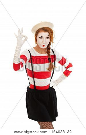 Portrait of a mime comedian showing OK isolated on white background