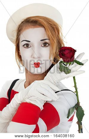 Portrait of the female MIM comedian with a rose flower isolated on white background