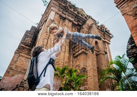 Father And Toddler Son Tourists In Vietnam. Dad Throws Up His . Po Nagar Cham Tovers. Asia Travel Co