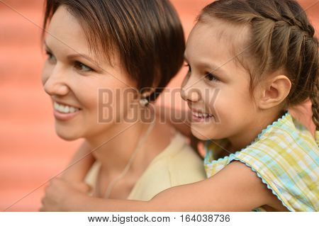 Portrait of a mother with her daughter, close up