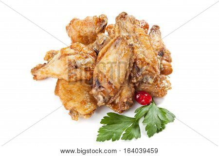 Roasted chicken drumsticks  isolated on a white background.